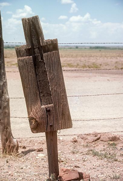 Cross on wood slab