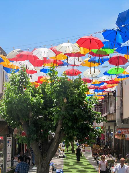 Umbrellas shade Turkish streets