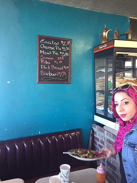 The bread list and the hostess at Za'atar's Mediterranean Restaurant.