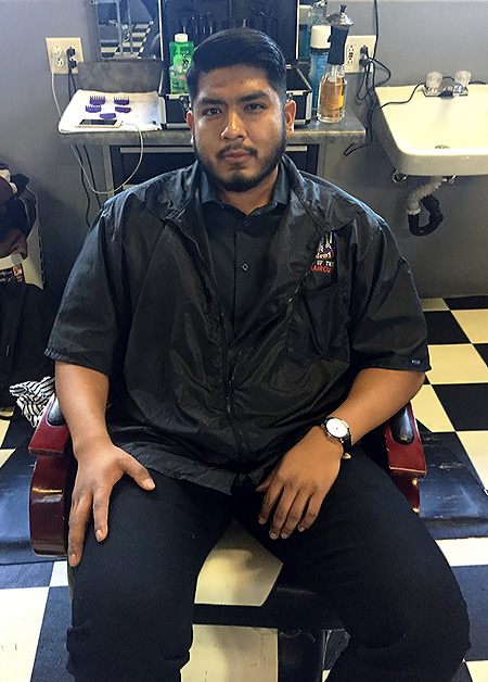 A student at The Dunbar Barber Academy